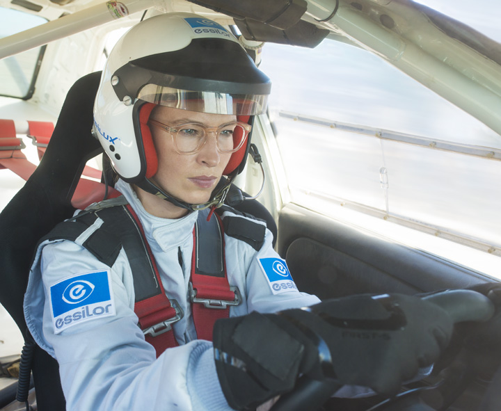 Female rally driver wearing Varilux X series lenses