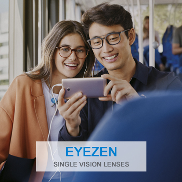 Young couple on bus wearing Eyezen lenses look at shared smartphone screen