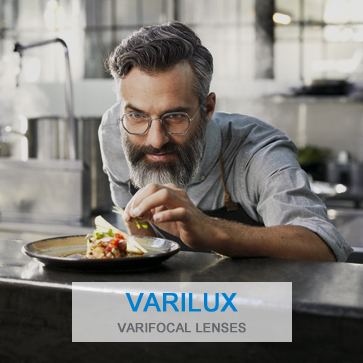 Chef wearing Varilux lenses makes last touches to meal preparation
